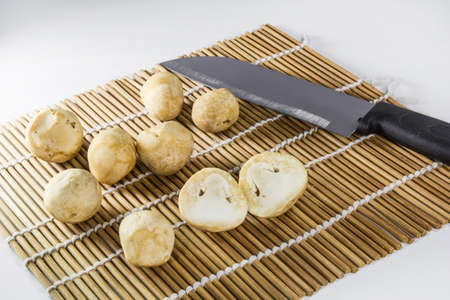 Straw mushroom for cooking, kitchen knife photo