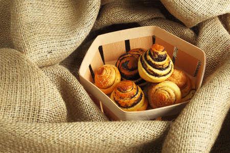 birchbark: Baked Goods with Poppy in Birchbark Basket Stock Photo
