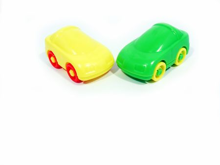 Two cars - a yellow and green, isolated on a white background Stock Photo