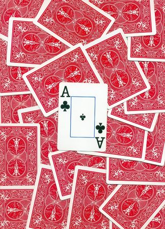 Background of the inverse of playing cards of different colors on the table isolated on white