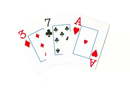 Playing cards of different colors on the table isolated on white background photo