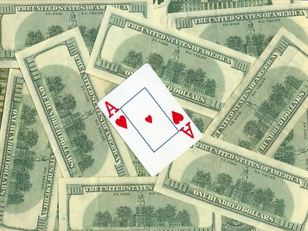 Background of money and playing cards isolated over white photo