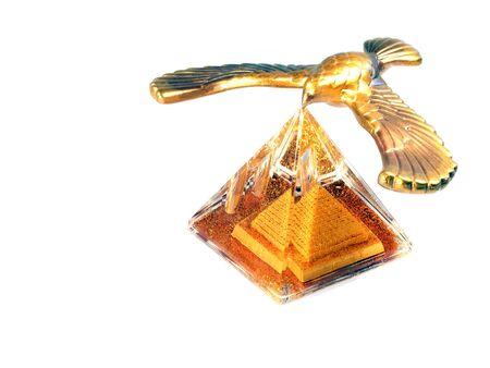 Souvenir eagle over pyramid isolated on white background photo