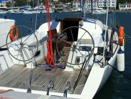 Marine yacht moored with two control columns with pier using ropes Stock Photo