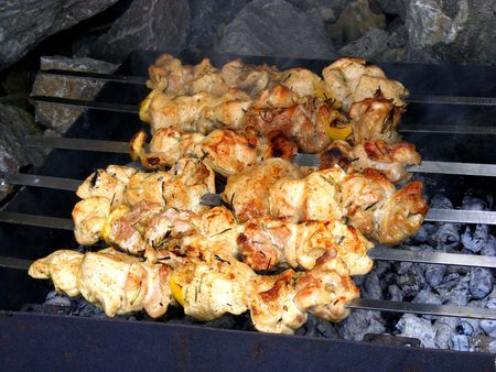 Barbeque meat with spices cooked over an open fire and coals