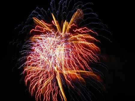 Firework from the bright lights of different colors against the dark sky Stock Photo