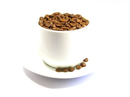 Coffee beans are in a cup isolated on a white background Stock Photo