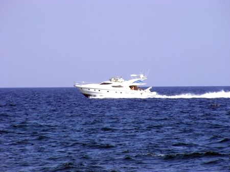 Marine boat is moving rapidly to large areas of sea water