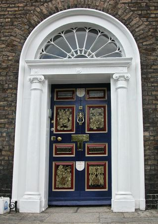 Georgian door in Dublin with pictures about irish life  Stock Photo
