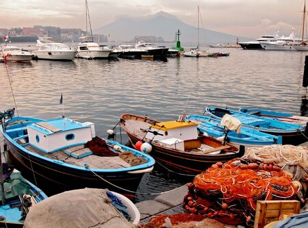 The fishing port of Naples and Vesuvius volcano as a background           photo