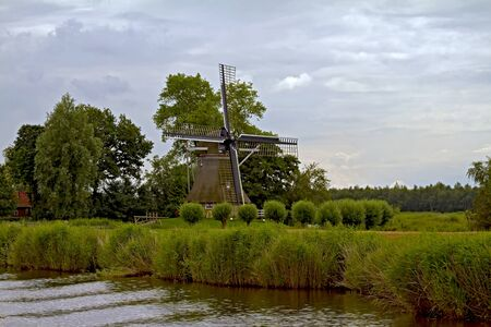 Traditional Dutch windmill on a canal