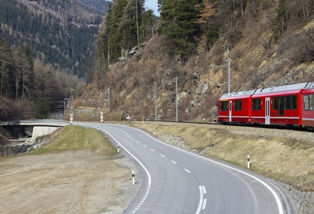 Scenic Railroad Pictures of Alps Train and road Stock Photo - 13474623
