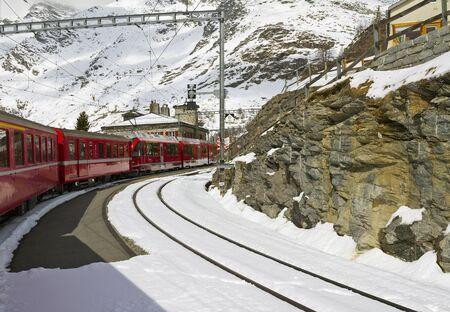 Red train at  Alp Grüm station on the Bernina railway Stock Photo - 14521265