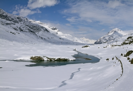 Lago Bianco is a lake at the Bernina pass in the Grisons, Switzerland. Stock Photo - 16847387