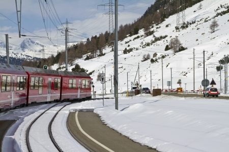 lacet: Winter scene near railway crossing at the Bernina Pass.