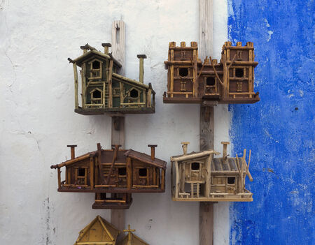 Funny starling-houses for migrant birds Stock Photo