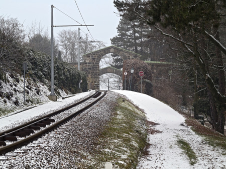 Winter railway track of mountain tramway in Linz photo