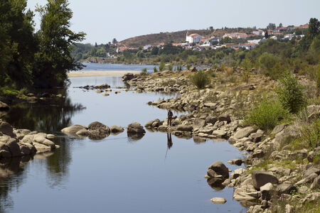 The narrow channel that separates the islet of Almourol  on the Tagus River Stock Photo