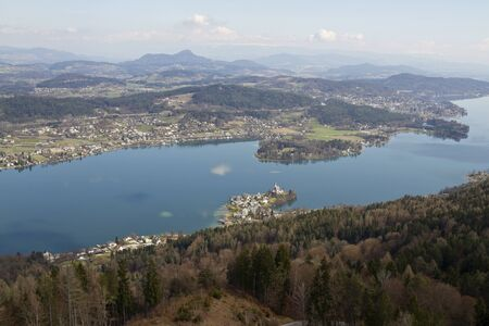 distinct: View of Woerthersee lake and Maria Worth from Pyramidenkogel Stock Photo