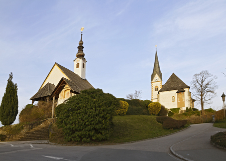 Catholic parish church of St. Primus and Felicianus and Rosenkranzkirche in Maria Wörth Stock Photo - 92531063