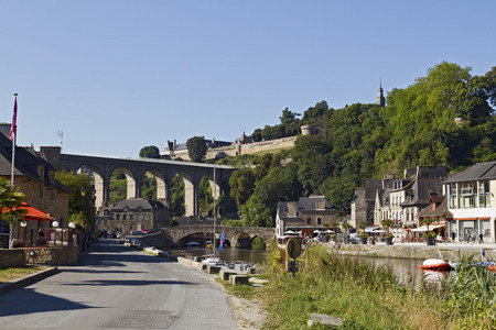 The Viaduc de Lanvallay and medieval town Dinan on the hilltop, France