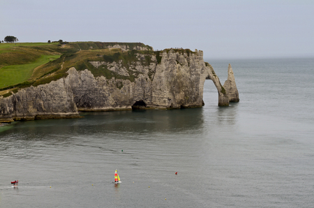 White Chalk Cliffs and Arches at Etretat in Normandy