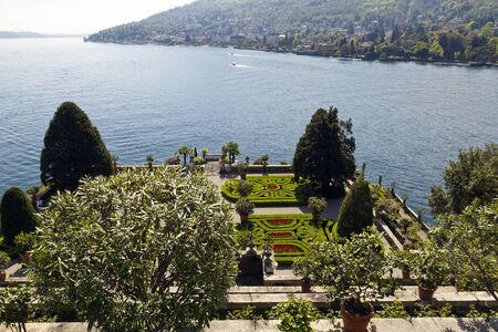 The terraced gardens of Isola Bella surrounded by the deep blue waters of Lake Maggiore