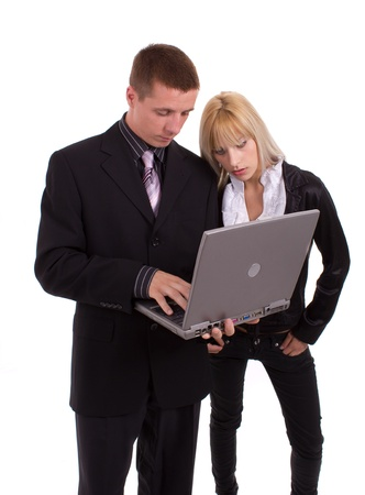 Businessman and woman using laptop