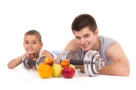 a boy and a man resting after exercise with fruit