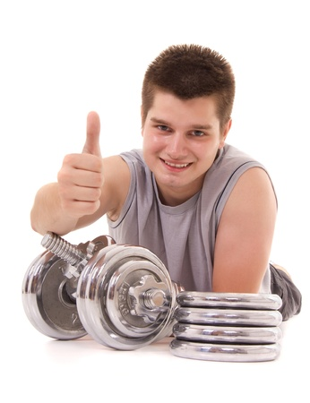 young man exercising with a dumbbell and pointing OK