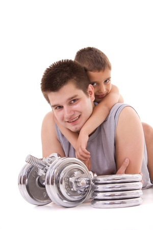 young  healthy man and son resting after exercise at gym photo