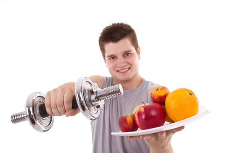 boy muscles: healthy young men exercise and hold fruits Stock Photo