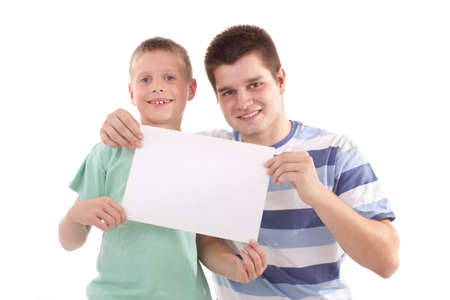 boy and men holding a billbord photo