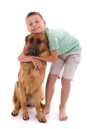 one dog: boy hugging his dog Stock Photo