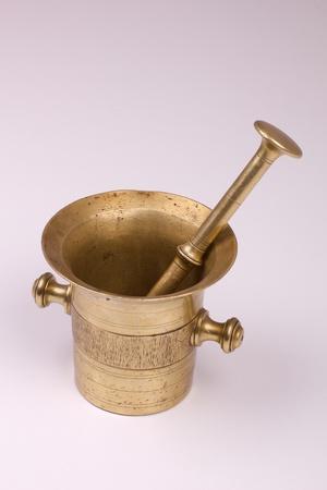 Antique bronze mortar and pestle photo