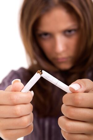 quiting: Young attractive woman quiting smoking isolated