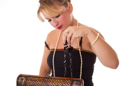 elegant women looking at jewelry box Stock Photo - 10677532
