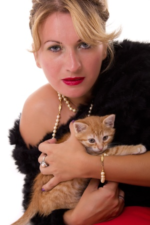 woman hold her cat and looking at the camera Stock Photo - 10677537