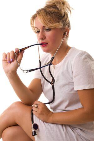 female doctor with stethoscope thinking someting Stock Photo - 10677541