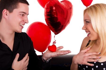 romantic guy gives  girl a  heart