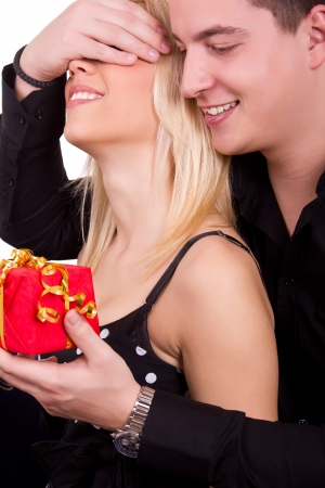 adult valentine: guy gives the girl a red gift