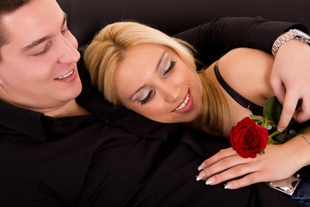 couple in love looking at red rose photo