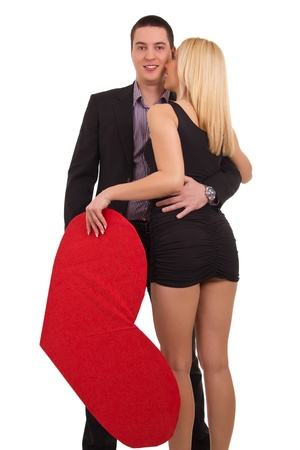 Girl gives guy a big red heart Stock Photo