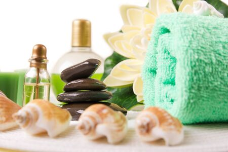scincare: Spa setting with Massage stones and soft towel Stock Photo