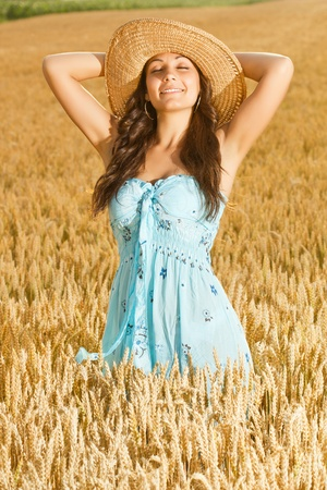 beautiful woman in field of wheat photo