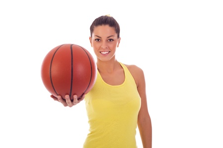 Portrait of a young attractive sporty woman holding a basket ball photo