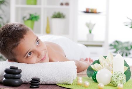 smal: boy ready for  massage in the spa salon