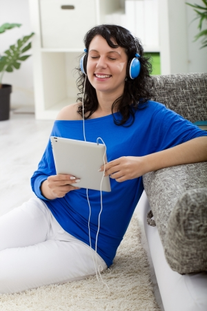 Young modern woman  with electronic tablet and headphones Stock Photo - 20685196