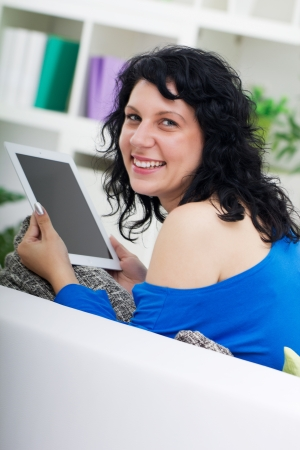 young woman using digital tablet photo