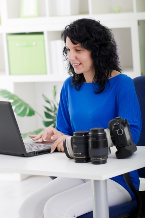 professional photographer working from home  with her camera equipment Stock Photo - 21502323